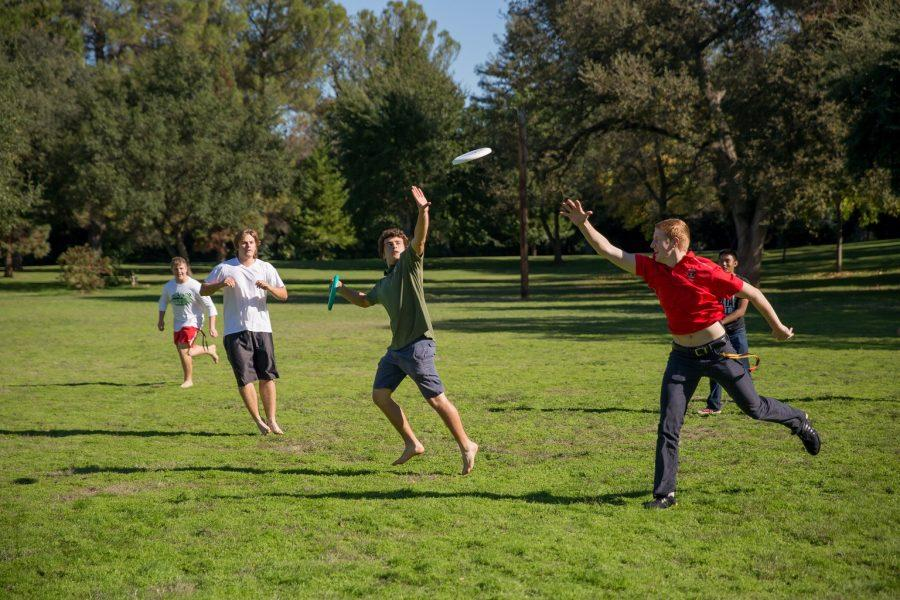 SRT LEader Tom McClain 17 playing frisbee with retreatants at lunch during a Junior Retreat at Christ the King Retreat Center.