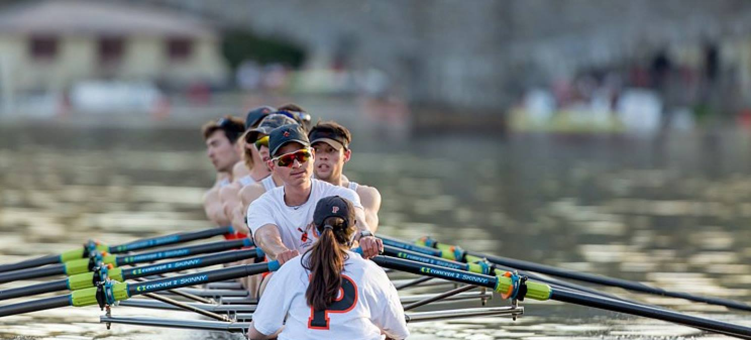 Tyler Valicenti '14, front, rows stroke seat during a Princeton Crew Practice.