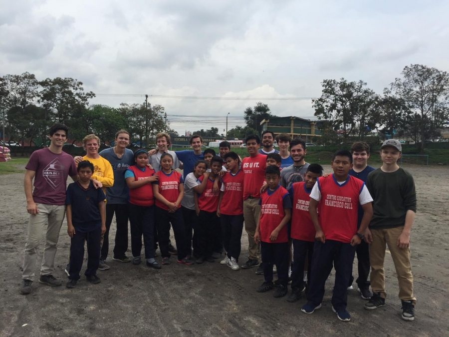 The+Guatemala+Immersion+Team+poses+for+a+picture+after+playing+soccer+with+students+from+a+District+Three+elementary+school.