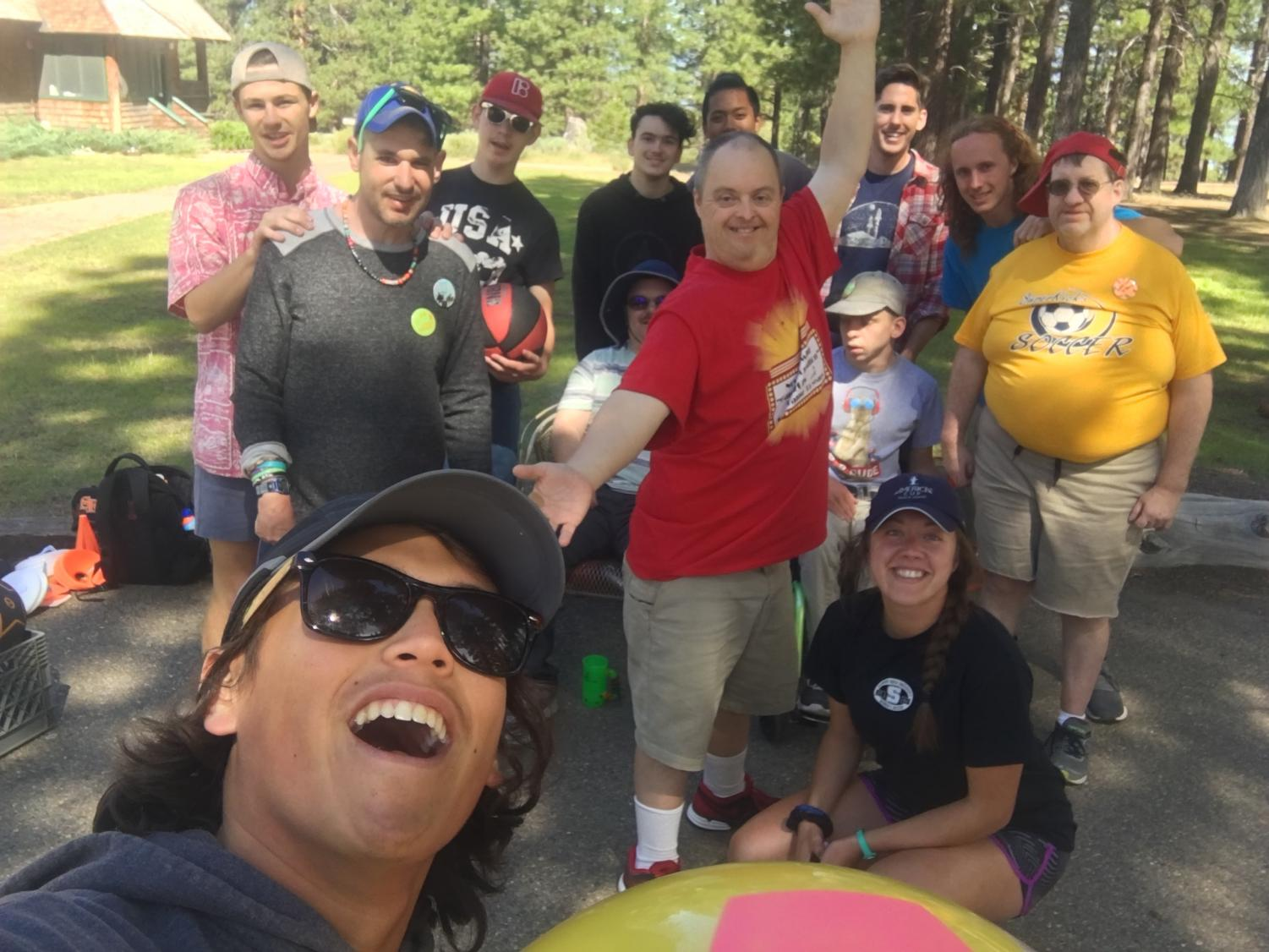 Camden Rothleder taking a selfie with his Camp ReCreation cabin group after playing kickball and basketball.