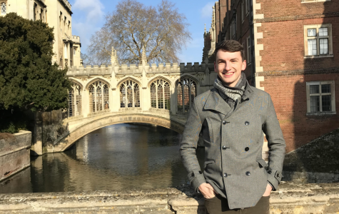 Greg Woollgar '13 stands in front of the Bridge of Sighs at St John's College in Cambridge University
