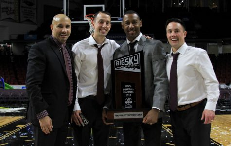 Jay Flores '07 (second from the left) pictured with the coaching staff of the University of Montana after winning the Big Sky Championship.
