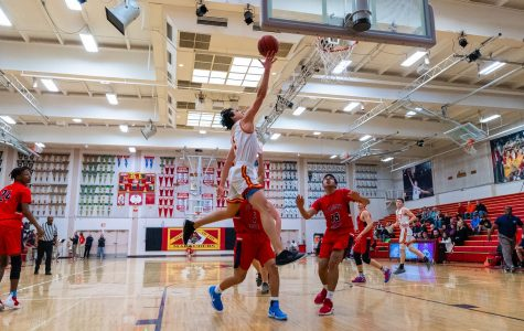 With added experience and size, expectations are running high for Jesuit basketball