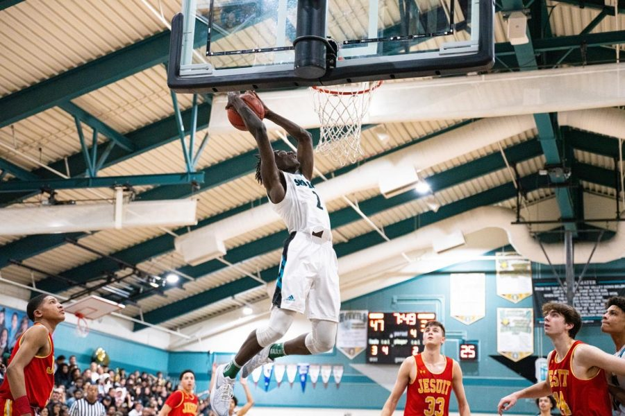 Sheldon+senior+guard+Xavion+Brown+attempts+a+dunk+in+the+fourth+quarter+of+a+basketball+game+between+Jesuit++and+Sheldon+on+Saturday%2C+Feb.+1.
