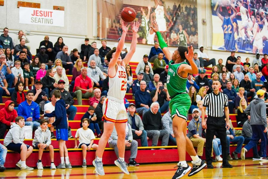 Jesuit Forward Matt Hoffman shoots three-point shot in game against St. Mary's High School in the Fr. Barry Gymnasium at Jesuit High School on Tuesday, Feb. 25.