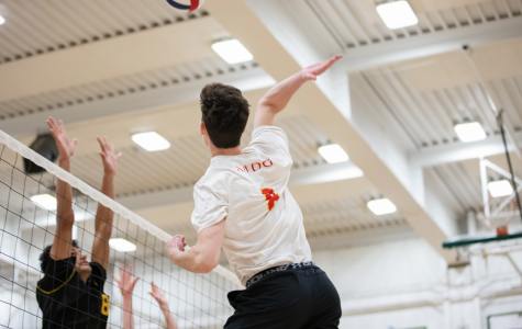 Logan Marks '20 hits volleyball in game against Rio Americano High School in Fr. Barry Gymnasium at Jesuit High School last season.