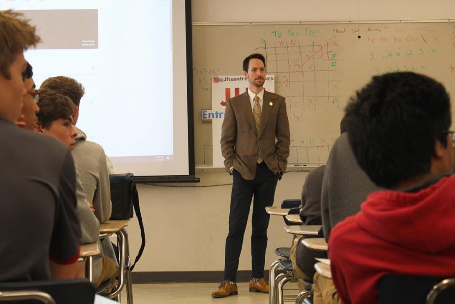 Raymond James Irwin '09, Chief Champagne Officer of Fizz Champagne & Bubbles Bar, speaks to members of the Jesuit High School Entrepreneurs Club on March 10, 2020.