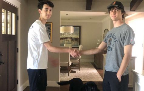 Pictured: newly appointed President Ronan Brothers '21 shaking hands with Vice President Jake Hall '21. Photo taken in February 2020 before Jesuit implemented