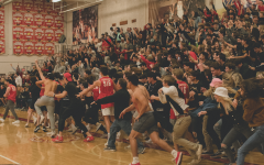 Jesuit High School students rush the court following Jesuit's victory over Christian Brothers High School.