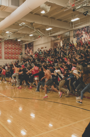 Jesuit High School students rush the court following Jesuit