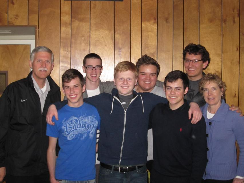 Mr. Tom McGuire, far left, and Ms. Cleann McGuire, far right, with Jesuit High School students in the