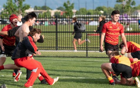 Members of the 2019 Jesuit High School rugby team rush the field after winning the National Championship.