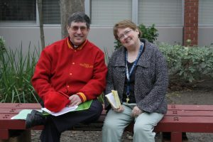 Ms. Maureen Pryor, right, with Fr. Kevin Leidich, S.J. in grace court.