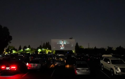 """Members of the senior Class of 2020 watching Jesuit's """"We Are One,"""" a movie celebrating their socially distanced graduation at the West Wind Drive-in Theater with their families, on Wednesday, June 3, 2020, in Sacramento, California."""