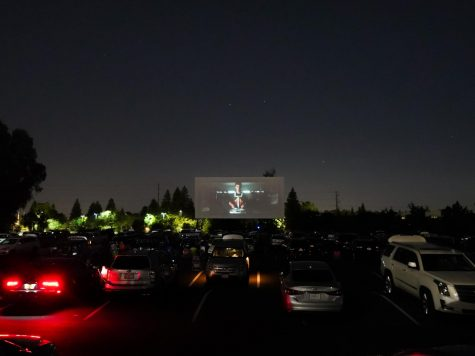 "Members of the senior Class of 2020 watching Jesuit's ""We Are One,"" a movie celebrating their socially distanced graduation at the West Wind Drive-in Theater with their families, on Wednesday, June 3, 2020, in Sacramento, California."
