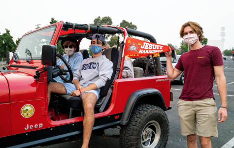 """From left to right, Matthew Sauls '21, Carlo Pedroncelli '21, and Xander Hinrichsen '21 during the """"Marauder takeover at the Drive-in"""" event at West Wind Sacramento 6 Drive-in on Wednesday, Sept. 9, 2020, in Sacramento, California."""