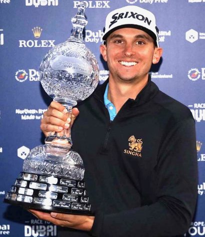John Catlin '09 holding his trophy after winning the Dubai Duty Free Irish Open on Sept. 27, 2020.