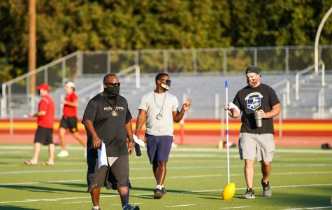 Head Varsity Football Coach Mr. Marlon Blanton, left, walking through a football practice at Jesuit High School on Oct. 7, 2020.