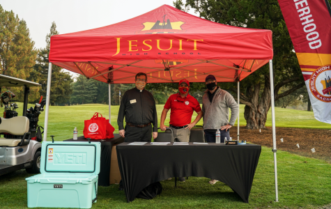 From left to right: Alumni Chaplain Rev. Edwin B. Harris, S.J., Director of Admissions & Alumni Relations Mr. Matthew Ramos '05, and New Admissions and Alumni Relations Associate Mr. Christopher Marshall '02 greet players as they arrive at the first tee, passing out gift bags and refreshments, while wearing masks for safety precaution. Taken at Ancil Hoffman Golf Course on Friday, Oct. 2, 2020 in Carmichael, California.