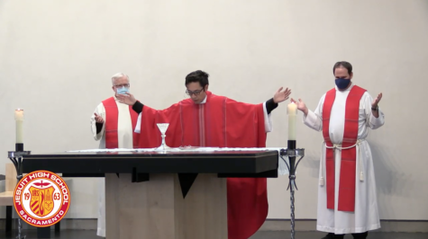 A screenshot from a YouTube livestream of the Feast of the North American Martyrs Mass in the Phelan Chapel of the North American Martyrs at Jesuit High School on Oct. 20, 2020.