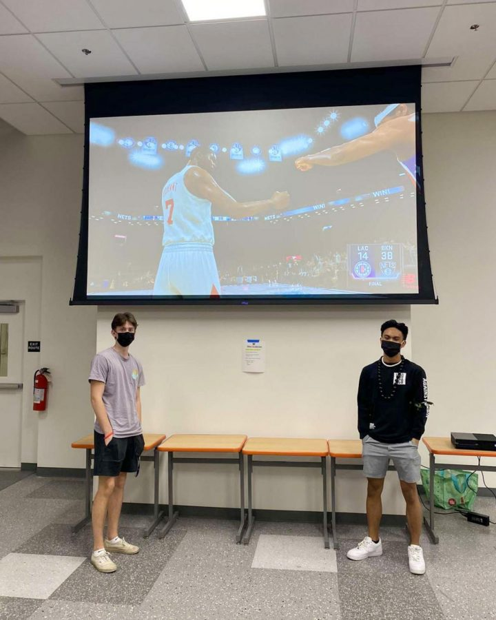 Jack Tilton '21, left, and Jared Manuel '21 after defeating Gabriel De La Torre '21 and John Romero '21 38-14 in the championship of the NBA2K tournament on Jan. 13.