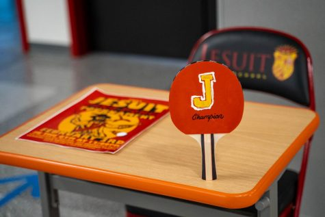Jesuit High School Sacramento's Pingpong Tournament trophy stands on a desk during the competition's check-in on Wednesday, Feb. 3, 2021.