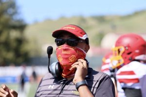Coach Chris Lee fills in as JV football coach