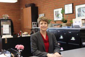 A dedicated servant in many ways, Ms. Colleen Arrigo retires from Jesuit